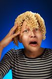 Shocked teen girl with macaroni instead hair Royalty Free Stock Image