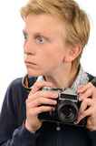Shocked teenage boy holding retro camera Royalty Free Stock Images