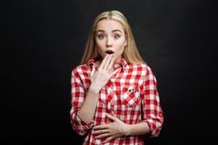 Shocked teenager expressing astonishment in the black colored studio Royalty Free Stock Photo