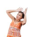 Shocked teenager in orange dress over white. Shocked teenager in orange dress royalty free stock photos
