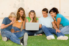 Shocked teens with laptop. Shocked or surprised teens with laptop computer or notebook Stock Photos