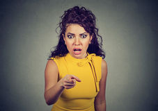 Shocked terrified woman pointing finger at camera Stock Images