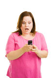 Shocked by Text Message Stock Photo