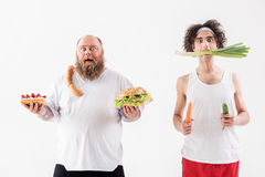 Shocked thick and thin men with different nutrition Royalty Free Stock Photo
