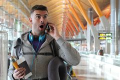 Shocked traveler getting an unexpected phone call.  Stock Photography