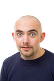 Shocked unshawen young bold man. Face of shocked frightened unshawen young bold man stock images
