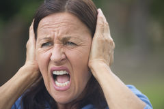Shocked upset mature woman outdoor Stock Photo