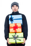 Shocked winter man with presents Stock Image