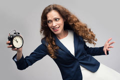 Shocked woman with alarm clock royalty free stock photo