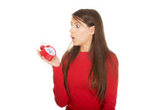 Shocked woman with alarm clock. Royalty Free Stock Image