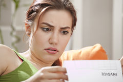 Shocked woman with bill Stock Photos