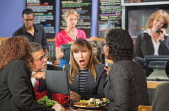 Shocked Woman in Cafe Royalty Free Stock Photo