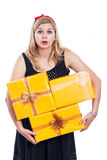 Shocked woman carrying presents Stock Photo