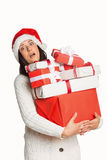 Shocked woman with christmas presents Stock Photography