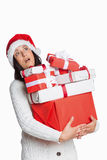 Shocked woman with christmas presents Royalty Free Stock Images