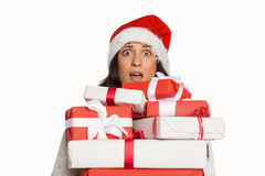 Shocked woman with christmas presents Stock Images