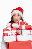 Shocked woman with christmas presents Royalty Free Stock Image
