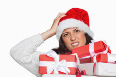 Shocked woman with christmas presents Stock Photo