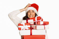 Shocked woman with christmas presents Stock Image