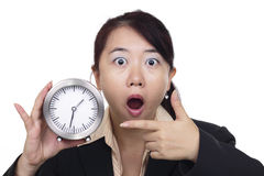 Shocked woman with clock Royalty Free Stock Image