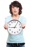 Shocked woman with clock. Portrait of shocked woman with clock over white background Royalty Free Stock Photos
