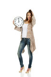 Shocked woman with clock. Stock Photography