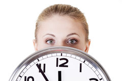 Shocked woman with clock. Portrait of shocked woman with clock over white background Stock Photo