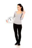 Shocked woman with a clock. Stock Photography