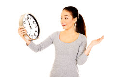 Shocked woman with a clock. Stock Image