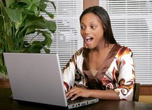 Shocked woman at computer Royalty Free Stock Photography