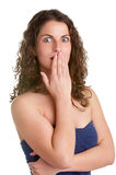 Shocked Woman Covering her Mouth Stock Photography