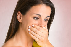 Shocked Woman Covering her Mouth Stock Image