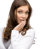 Shocked woman covering her opened mouth Royalty Free Stock Images