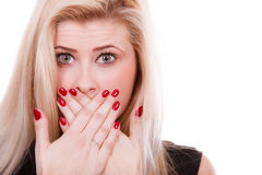 Shocked woman covering mouth with hands Stock Photography