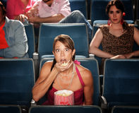 Shocked Woman Eats Popcorn Royalty Free Stock Photo