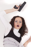 Shocked woman with gun Royalty Free Stock Photography