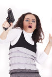Shocked woman with gun Stock Image