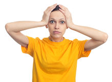 Shocked woman with hands on her head. Isolated Stock Photo