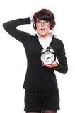 Shocked woman holding alarm clock Stock Photography