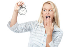 Shocked woman holding alarm clock Royalty Free Stock Photo