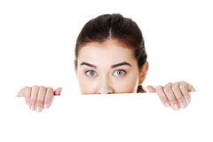 Shocked woman holding blank board Stock Photography