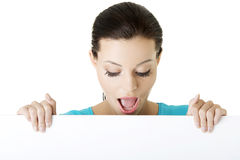 Shocked woman holding blank board Stock Photo