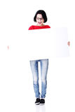 Shocked woman holding blank board Royalty Free Stock Photo