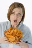 Shocked Woman Holding Bowl Of Nachos Royalty Free Stock Photo