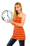Shocked woman holding clock Stock Photo