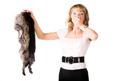 Shocked woman holding fur skin Stock Photography