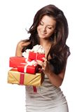 Shocked Woman holding Gift Box.White background Stock Photos