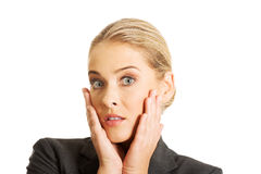 Shocked woman holding hands on chin Royalty Free Stock Photos