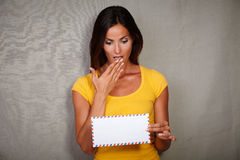 Shocked woman holding letter while standing Royalty Free Stock Image