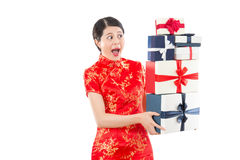 Shocked woman holding many gift boxes Royalty Free Stock Photography